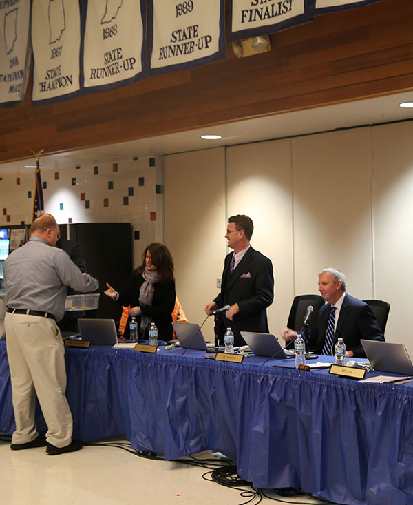 Mr. Reininga gives the Board the student gifts