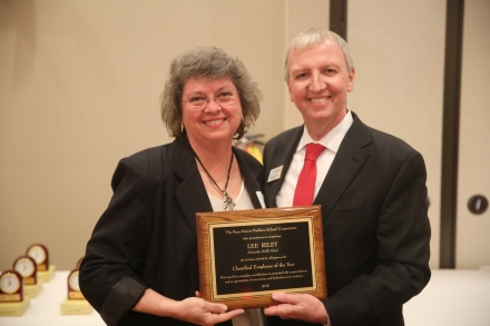 Lee Riley accepting her EOY plaque from P-H-M Supt. Dr. Jerry Thacker